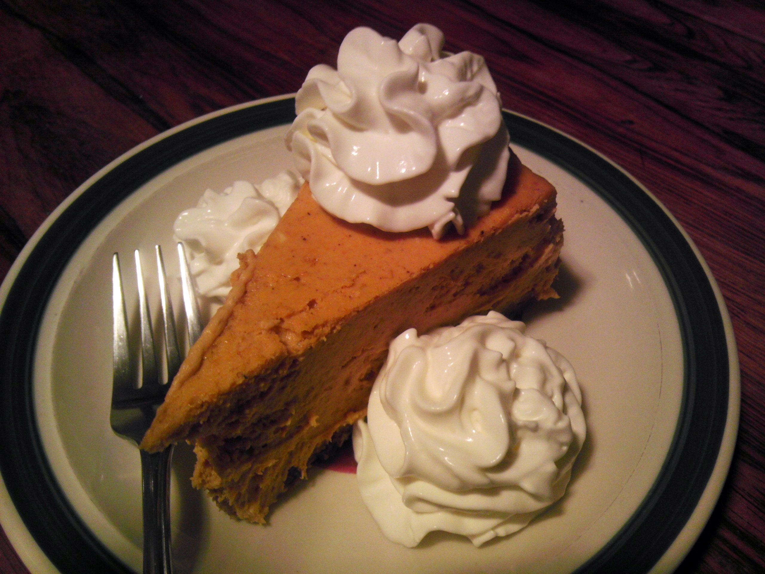 pumpkin-pie-with-whipped-cream-on-top